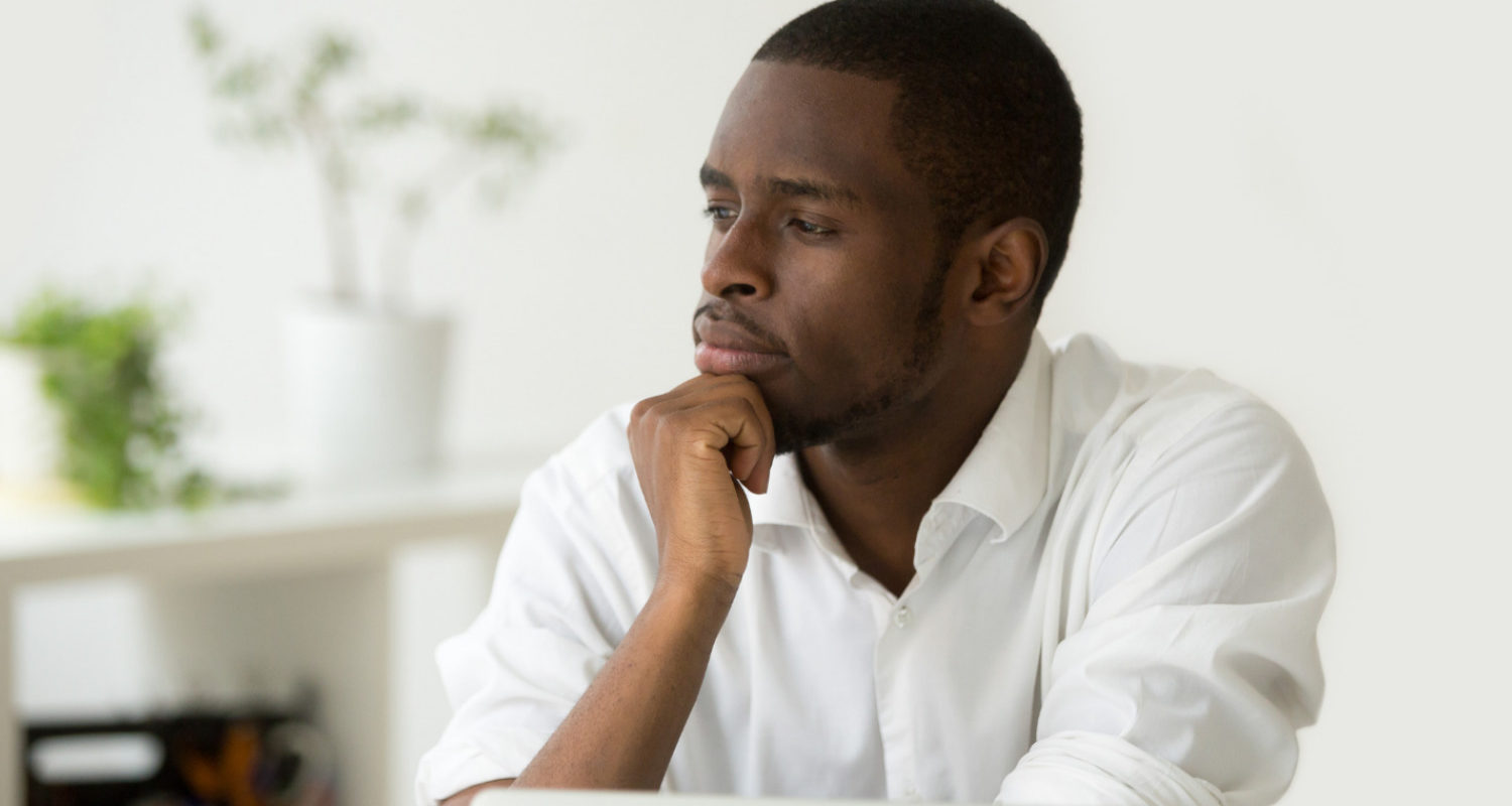 Man practicing daily reflection in his office.